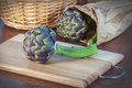 Artichoke on wood table closeup Stock Photography