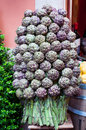 Artichokes composition of globe banded in a tree and set as a decoration in italian cafe Stock Photos