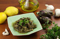 Artichokes with garlic and parsely Stock Images