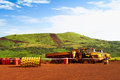 Articulated haul trucks on mine site in africa dump mining construction sierra leone Royalty Free Stock Photos