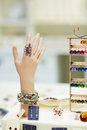 Artifical hand to display jewelry and rings in a jeweler shop Royalty Free Stock Photo