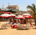 Artificial beach the with umbrellas chairs and sand in the restored first station hatachana in hebrew complex in jerusalem Royalty Free Stock Photography