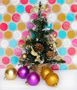 Artificial Christmas fir tree with balls and pine cone Royalty Free Stock Photo