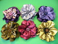Artificial fabric flowers Stock Photos