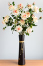 Artificial flowers in a brown vase Royalty Free Stock Images