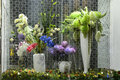 Artificial flowers and plants in glass case Royalty Free Stock Photo
