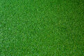Artificial grass grass turf is a surface of synthetic fibres made to look like natural it is most often used in arenas for sports Stock Photo