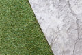 Artificial grass with stone floor texture backgroud