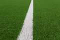 Artificial grass with white line on soccer field Royalty Free Stock Photography