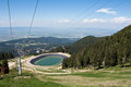 Artificial lake for artificial snow this was build to supply water during winter this slope becomes a ski slope in winter Stock Images