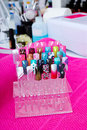 Artificial nails on the stand in manicure salon Stock Image
