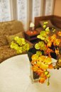 Artificial orchids in living room fabric on a round table a Royalty Free Stock Image