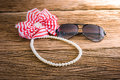 Artificial pearl necklace and sunglasses, Hair bow Royalty Free Stock Photo