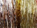 artificial rain of silver and golden colors. Royalty Free Stock Photo
