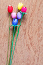 Artificial tulips flower made from silk cocoon on plywo