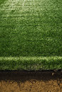 Artificial turf at soccer field green plastic grass as background Stock Photos