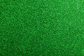 Artificial turf. Studio shot. Green background. Copy space. Royalty Free Stock Photo