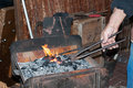 Artisan blacksmith working in his workshop Royalty Free Stock Photo