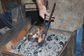 Artisan blacksmith working in his workshop Royalty Free Stock Image