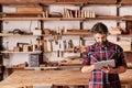 Artisan carpenter in his woodwork studio using digital tablet Royalty Free Stock Photo