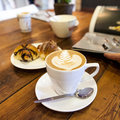 Artisan coffee on wooden table with croissant. Royalty Free Stock Photos