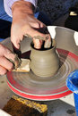 Artisan creates a clay pot with a lathe Royalty Free Stock Photos