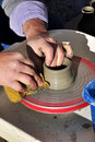 Artisan creates a clay pot with a lathe Stock Photos