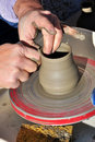 Artisan creates a clay pot with a lathe Stock Photography