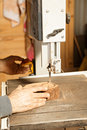 Artisan hands sawing billet Royalty Free Stock Images
