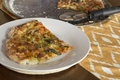 Artisan pizza home made veggie pie with onions peppers spinach and olives Stock Photo