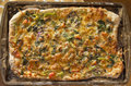 Artisan pizza home made veggie pie with onions peppers spinach and olives Royalty Free Stock Photos