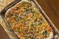 Artisan pizza home made veggie pie with onions peppers spinach and olives Stock Photos