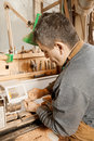 Artisan processing pipe on lathe Stock Image