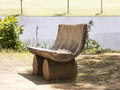 Artisanal riverside bench made of three tree trunks two medium one to support the seat made of a huge trunk from which the inside Royalty Free Stock Photography