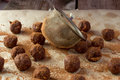 Artisanal truffle balls and sieva shot of sieve Royalty Free Stock Photography
