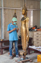 Artisans renew damaged by war buddha statues in the workroom luang prabang laos march at former royal palace on march laotian Royalty Free Stock Photos