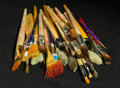 Artist brushes for painting on a dark background Royalty Free Stock Photography