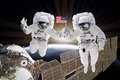 Artist creative edit composite depicting teamwork on ISS Royalty Free Stock Photo