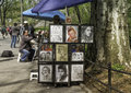 Artist draws central park new york an and sells caricatures in manhattan city Stock Image