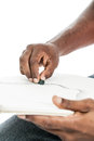 Artist hands close up of a black man s drawing with pastels on a sketch pad Stock Photos