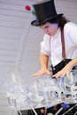 Artist holds lot of glasses on stage moscow august at festival street theater and carnival culture once in park it garden named Royalty Free Stock Photos
