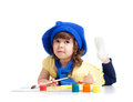 Artist kid girl painting over white background Stock Photos