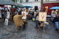 Artist at montmartre in paris photo of france on drawing a woman many artists congregate here Royalty Free Stock Image