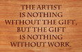 The artist is nothing without the gift but work quote by emile zola on wooden red oak background Royalty Free Stock Images