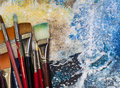 Artist Paint Brushes on a Painting Royalty Free Stock Photo