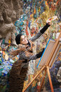 Artist, painter woman with canvas on mosaic background Royalty Free Stock Photo