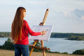 Artist painting an sea landscape Royalty Free Stock Images