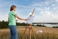 Artist painting an sea landscape woman Royalty Free Stock Image