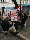 An artist paints on a cloudy day paris sep dayin montmartre square sep in paris Royalty Free Stock Photos