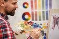Artist paints with oil paints